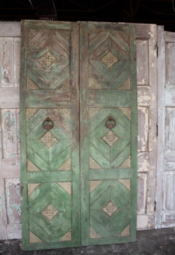 Teak Doors with faded green paint tones from a Merchant&#39;s Haveli, Gujarat circa 1900 <b>sold<b>